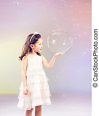 Funny lovely little girl playing with soap bubbles - Funny...