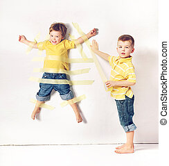 Two little brothers having great fun - Two cute little...