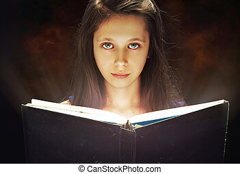 Young girl reading an old book - Young girl reading the old...