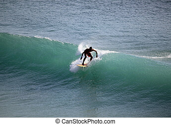 Surfer in ocean - Young men - the surfer in ocean. Bali....