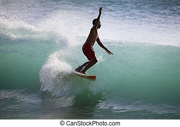 Surfer  - Young men - the surfer in ocean. Bali. Indonesia
