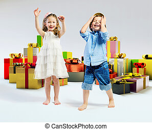 Happy kids with lots of gifts - Happy children with lots of...