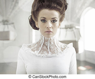 Fine art photo of a young fashion lady in a stylish interior...
