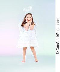 Cute little girl as an angel