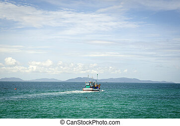 Wooden fishing boat out to sea