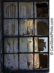 Broken panes - A window with all panes broken by vandals.