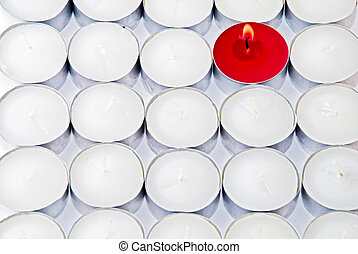 Be different! - One red candle among lots of white candles
