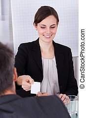 Businesspeople Exchanging Visiting Card - Happy...