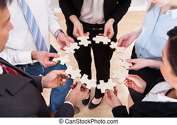 Business People Holding Jigsaw Puzzle - High Angle View Of...