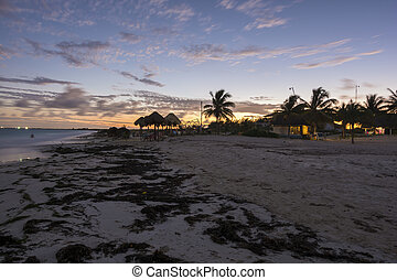 Tropical beach sunset - Tropical Caribbean public beach on...