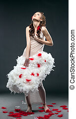 Cute curly woman posing with angel wings