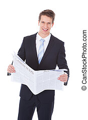 Happy Young Businessman Holding Newspaper