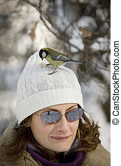 Great Tit alighted on girl\'s head