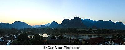 Panorama of Vang Vieng at sunset, Laos.