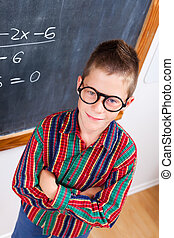 Smart schoolboy at chalkboard - Eminent schoolboy wearing...