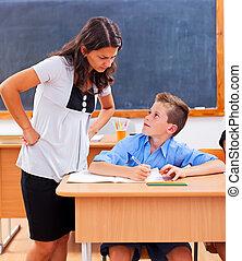 Teacher looking at pupil's homework