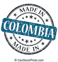 made in COLOMBIA blue grunge stamp isolated on white...