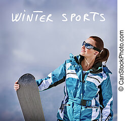 Winter sports - Cute young snowboarder girl having fun...