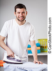 Daily chores - Man ironing clothes and doing daily chores