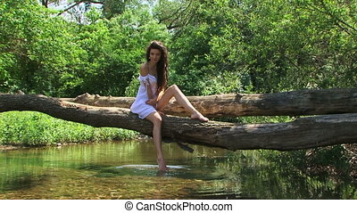 On a riverside - Brunette model posing on a riverside