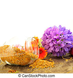 Bee pollen copy space - Bee pollen in glass jar and flowers...