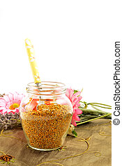 Bee pollen in glass jar and spoon