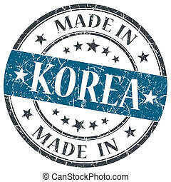 made in Korea blue grunge round stamp isolated on white...