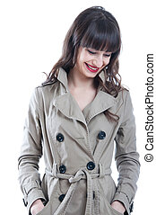 Woman in a rain coat - Beautiful young brunette woman model...