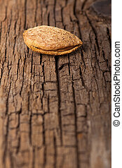 Almond on wooden board