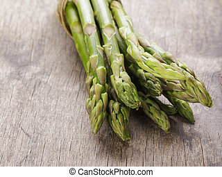 bunch of green asparagus tied with twine, rustic style for...