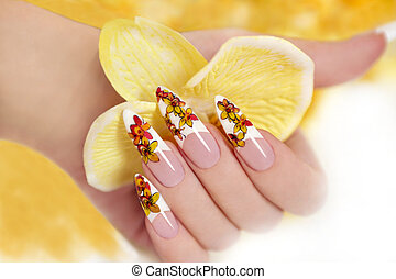 Yellow orchids - Nail with a pattern of yellow orchids on a...