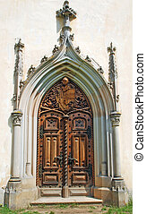 Ancient portal - Medieval gothic portal with heraldry...