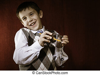 Pojke, hålla, rullat, kassett, remsa, tejpa, blyertspenna