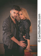 fifties fashion couple in leather jackets,
