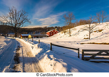 Fence and farm field along a snow-covered road in Seven Valleys, Pennsylvania.