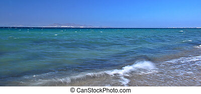 Sea surf - Beautiful blue sea with a waves hitting the beach