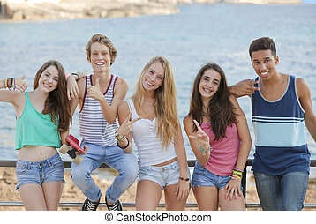 group of confident teens with thumbs up and v signs