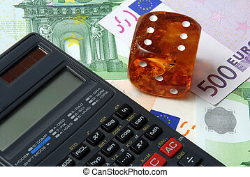 Hazard of business - calculator with dice on money...