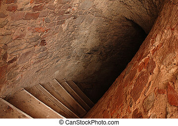 Down to catacombs - Ancient stairway in abandoned ruined...