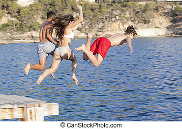 kids jumping in sea or ocean
