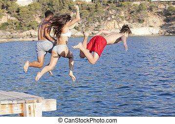 kids jumping in sea or ocean