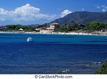 Sardinia - Beauitiful bay of Nora on Sardinia with yacht and...