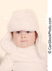 cute baby in furry hat