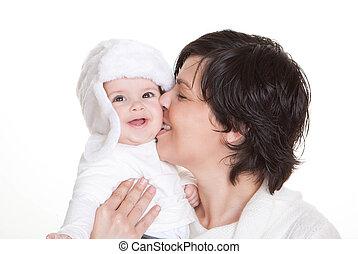 mum kissing baby child