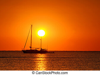 Sunset and boat - Sailing boat silhouette and golden sunset...