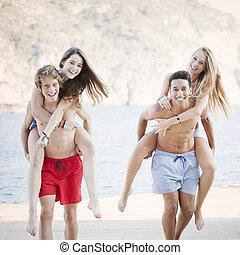 diverse teens playing piggyback
