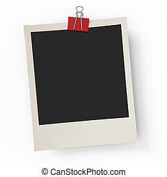 The photo hanging on an office paper clip on a white...