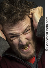 Angry Man - An angry man with a bad temper tearing his hair...