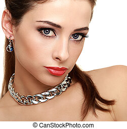 Sexy makeup woman with long lashes and necklace looking....