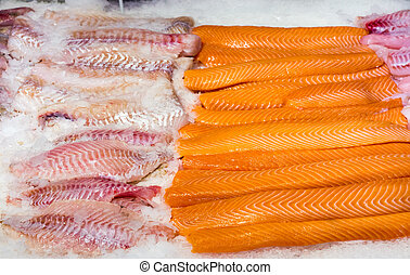Fresh salmon and cod filet seen at the fishmarket
